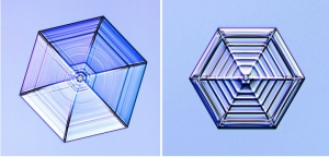 The crystal on the right was subjected to periodic temperature changes that yielded a spider's-web pattern of ridges and ribs.